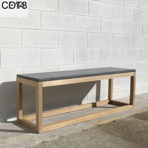 Geelong-made concrete bench seat with hardwood legs