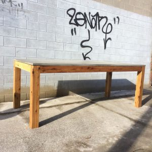 Geelong-made concrete dining table, hardwood legs
