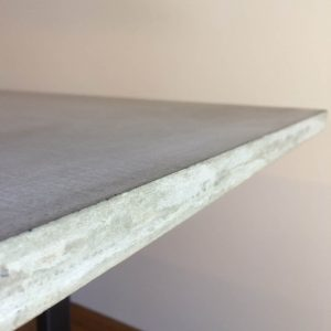 Concrete dining table with matt black legs in Geelong