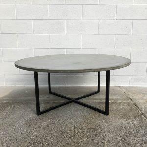 Round concrete coffee table with matt black legs, Geelong