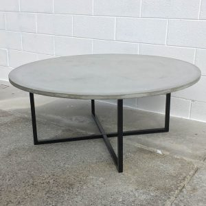 Round concrete coffee table with matt black legs in Geelong