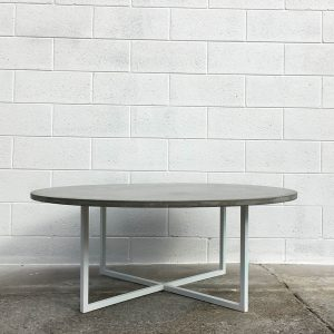 Round concrete table with white legs, Geelong